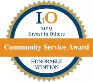 invest in others community service award